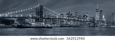 Panoramic view New York City Manhattan downtown skyline at night with skyscrapers in blue tonality - stock photo