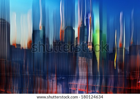 Panoramic view New York City Manhattan downtown skyline at night with skyscrapers in motion blur - stock photo