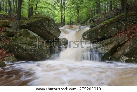 Panoramic view of a beautiful spring waterfall. - stock photo