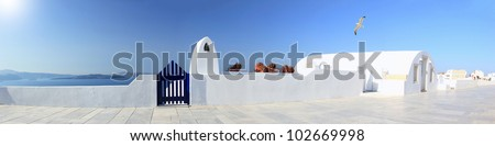 Panoramic view of a Classical Greek architecture of the streets in the Cyclades Greece - stock photo