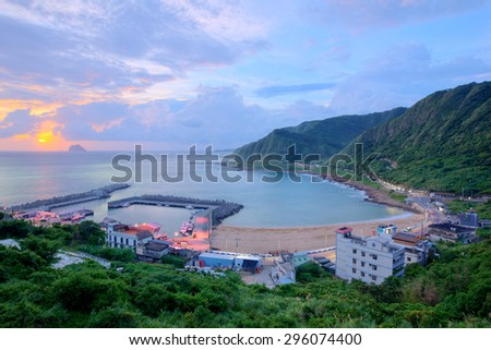 Panoramic view of a fishing village at dawn on northern coast of Taipei Taiwan - stock photo