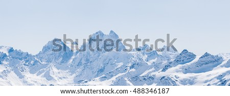 Panoramic view of a snowy winter Greater Caucasus mountains at sunny day. Mt. Elbrus, Kabardino-Balkaria, Russia