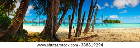 Panoramic view of a tropical beach at dawn. Praslin island, Seychelles, Indian Ocean. - stock photo