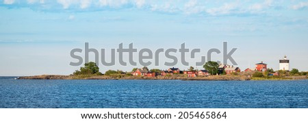 Panoramic view of a white lighthouse with red buildings, Svartklubben in Sweden - stock photo