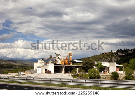 Panoramic view of a white rusty old factory on a cloudy sky.  Old withe factory.  - stock photo