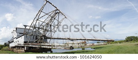 Panoramic view of abandoned tin mining dredge at Tanjung Tualang, Malaysia. - stock photo