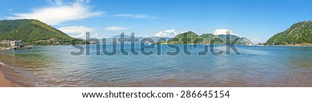 panoramic view of Aegean sea bay withgreen islands from Icmeler beach against clear blue sky, Turkey - stock photo