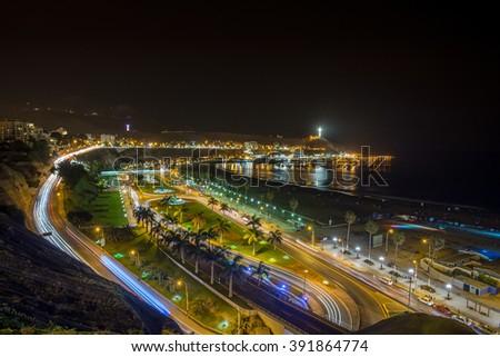 Panoramic view of Aguadulce beach in the night, Chorrillos, Lima, Peru. - stock photo