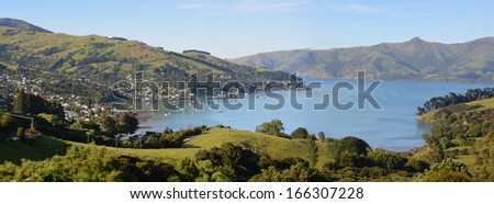 Panoramic view of Akaroa township - one of New Zealand's most popular tourist and cruise boat destinations. - stock photo