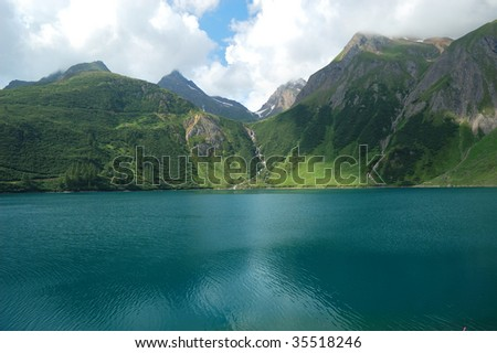 Panoramic view of an alpine lake (Morasco lake, Italy)