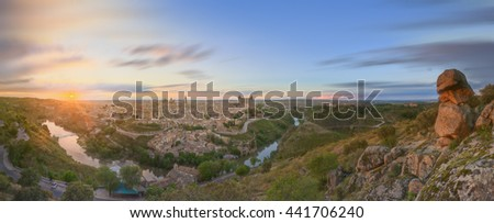 Panoramic view of ancient city and Alcazar on a hill over the Tagus River, Castilla la Mancha, Toledo, Spain. - stock photo