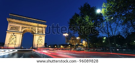 Panoramic view of Arc de Triomphe by night, Paris - stock photo
