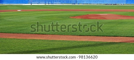 Panoramic view of baseball diamond, showing the pitcher's mound and second base - stock photo