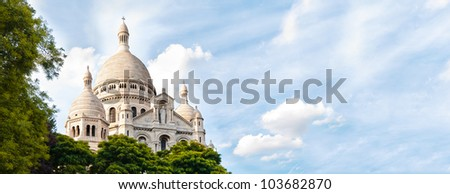 Panoramic view of Basilica of the Sacred Heart of Paris with blue cloudy sky in background (Paris, France, Europe). - stock photo