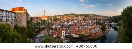 Panoramic view of beautiful city Cesky Krumlov with castle and church on river Vltava, Czech republic