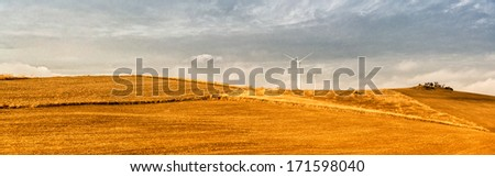 Panoramic view of beautiful landscape and windmills. Southern Spain in winter - stock photo
