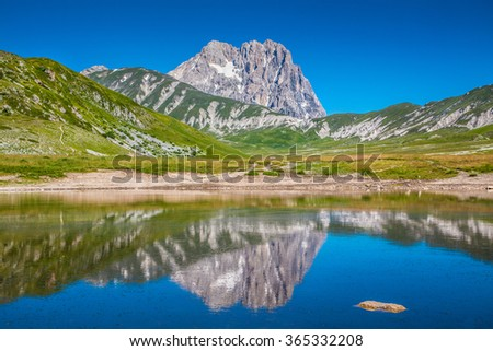 Panoramic view of beautiful landscape with Gran Sasso d'Italia peak at Campo Imperatore plateau in the Apennine Mountains, Abruzzo, Italy - stock photo