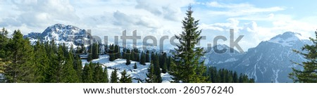 Panoramic view of beautiful snow covered mountains and rocky peaks in the Bavarian Apls