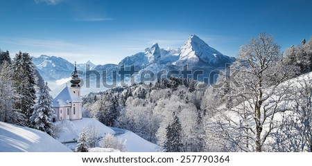 Panoramic view of beautiful winter landscape in the Bavarian Alps with pilgrimage church of Maria Gern and famous Watzmann massif in the background, Nationalpark Berchtesgadener Land, Bavaria, Germany - stock photo