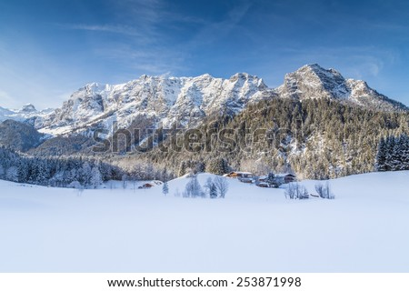 Panoramic view of beautiful winter mountain landscape in the Bavarian Alps with Reiteralpe mountain range in the background, Nationalpark Berchtesgadener Land, Upper Bavaria, Germany - stock photo