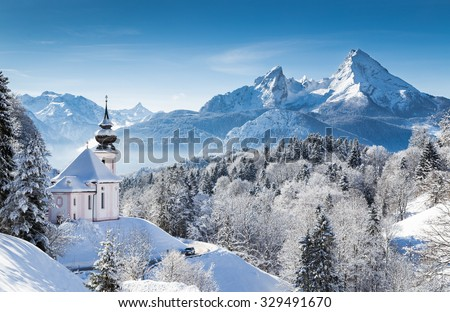 Panoramic view of beautiful winter wonderland mountain scenery in the Alps with pilgrimage church of Maria Gern and famous Watzmann summit in the background, Berchtesgadener Land, Bavaria, Germany - stock photo