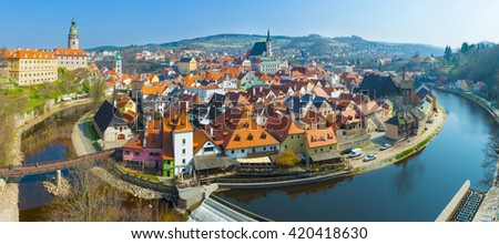 Panoramic view of bend of river Vltava and historical centre of beautiful Czech city Cesky Krumlov - stock photo