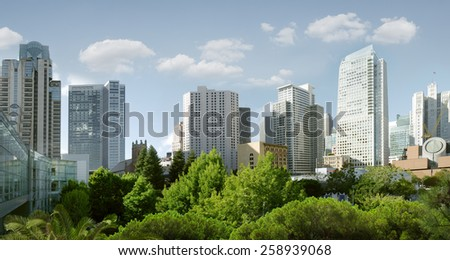 panoramic view of big modern city during summer morning - stock photo