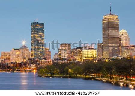 Panoramic view of Boston in Massachusetts, USA at night showcasing its mix of modern and historic architecture.