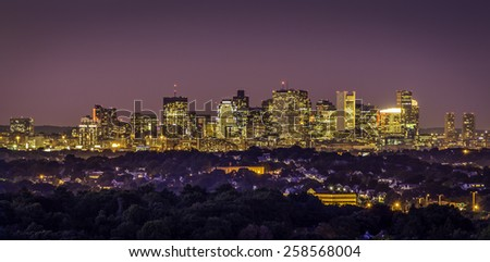 Panoramic view of Boston in Massachusetts, USA at sunset showcasing the architecture of its Financial District. - stock photo