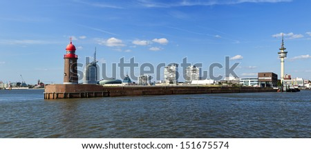 Panoramic view of Bremerhaven with historic lighthouse on the pier in foreground - stock photo