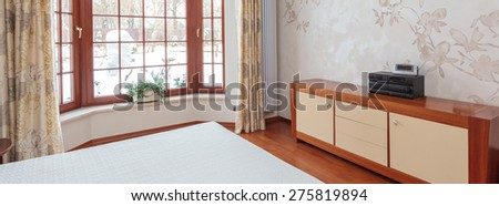 Panoramic view of bright bedroom with huge window - stock photo