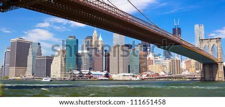 Panoramic view of Brooklyn Bridge and Lower Manhattan skyline in New York - stock photo