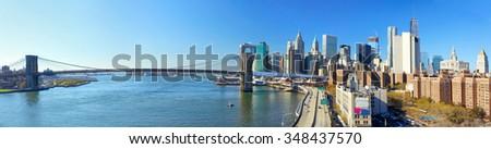 Panoramic view of Brooklyn Bridge and Lower Manhattan skyline, New York City - stock photo