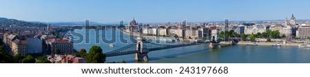 Panoramic view of Budapest: chain Secheni Bridge through the river Danube and Parliament - stock photo