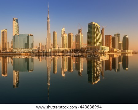 Panoramic view of Business bay and downtown area of Dubai, reflection in a river, UAE. - stock photo