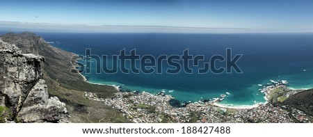 Panoramic view of Camps Bay, a suburb of Cape Town, South Africa. Shot taken from the top of Table Mountain. - stock photo