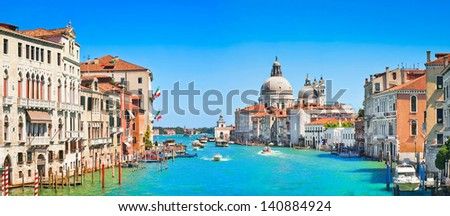 Panoramic view of Canal Grande with Basilica di Santa Maria della Salute in Venice, Italy - stock photo