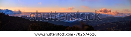 Panoramic view of Cerro de la Muerte Costa Rica with a volcano in the clouds, illuminated by the setting sun. Mountain landascape. Los Quetzales National Park Nature Reserve. Costa rica.