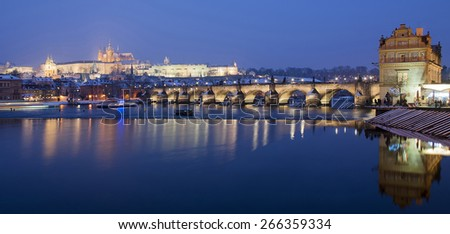 Panoramic view of Charles Bridge and Hradcany Castle by night - Prague - stock photo