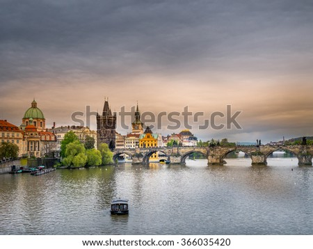 Panoramic view of Charles Bridge and Tower over the Vltava river in Praque,Czech Republic - stock photo