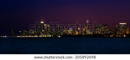 Panoramic view of Chicago skyline at night - stock photo