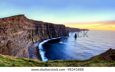 Panoramic view of Cliffs of Moher at sunset in Ireland. - stock photo