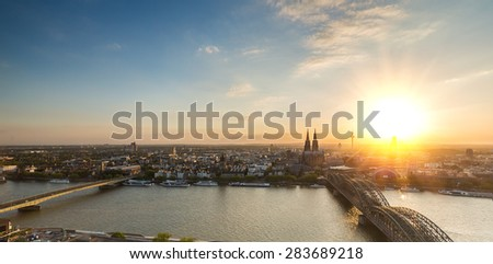 panoramic view of Cologne and the Cologne cathedral at sunset - stock photo