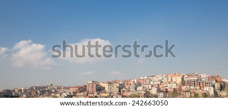 Panoramic view of colorful houses and mosque on a hillside in Istanbul, Turkey - stock photo