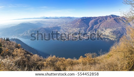 Panoramic view of Como lake in late autumn, Italy. View from Brunate town. Cernobbio city and Swiss Alps on the background
