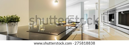 Panoramic view of countertops in designed kitchen - stock photo