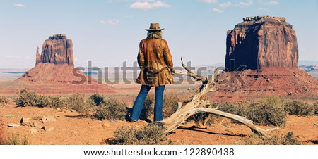 panoramic view of cowgirl at Monument Valley, Utah, USA - stock photo