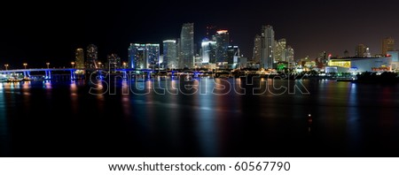Panoramic view of Downtown Miami and Biscayne Bay in the evening with colored reflections of the skyscrapers in the bay. - stock photo