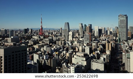 Panoramic view of downtown Tokyo city skyline with Mount Fuji in the background.   - stock photo