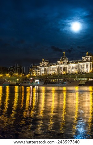 Panoramic view of Dresden in night and the river Elbe.